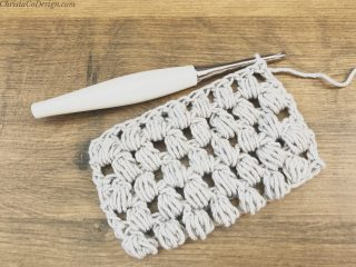 picture of crochet swatch in grey of pineapple cluster stitches