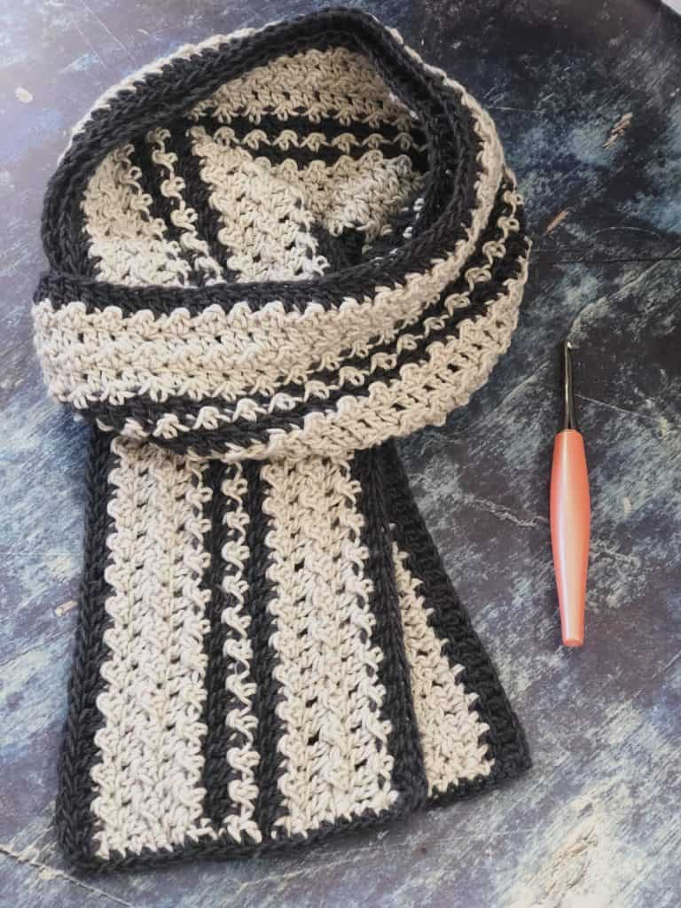 Men's striped textured crochet scarf pattern in light grey and dark grey.