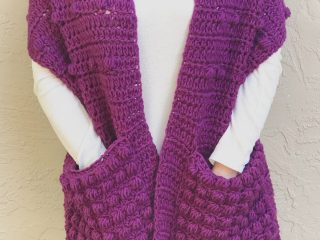 picture of crochet pocket shawl free pattern in purple with pineapple stitch pockets