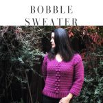 A woman looks to the side while modeling the Briones Bobble Sweater Crochet Pattern in pink.