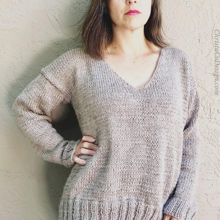 Woman wearing Elena v-neck knit sweater in beige.