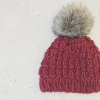 picture of maroon knit hat with Pom Pom