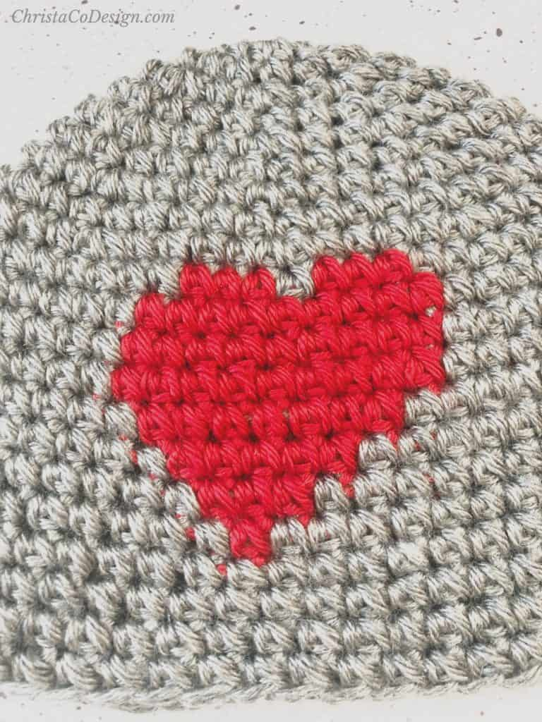 picture of center heart design in red crochet on grey