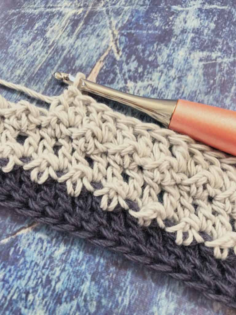 picture of stripes and textures in grey and peach ergonomic crochet hook