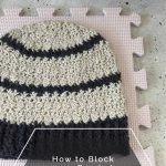 Grey striped hat on blocking mat.
