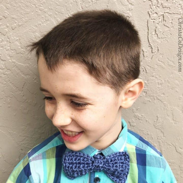 Boy in blue crochet bowtie.