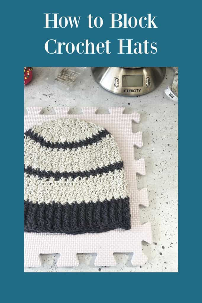 Crochet hat with stripes drying on blocking board.