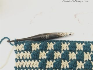Crochet bobbles in blue and beige stitches.