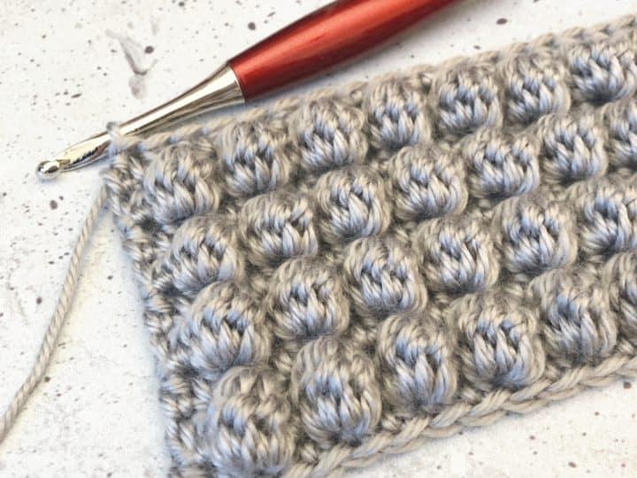 Grey swatch of crochet bobbles.