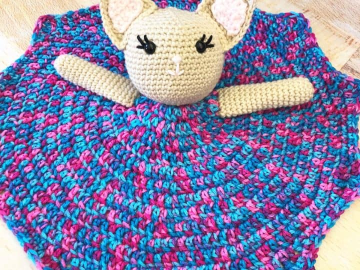 Crochet kitty lovey with purple dress.
