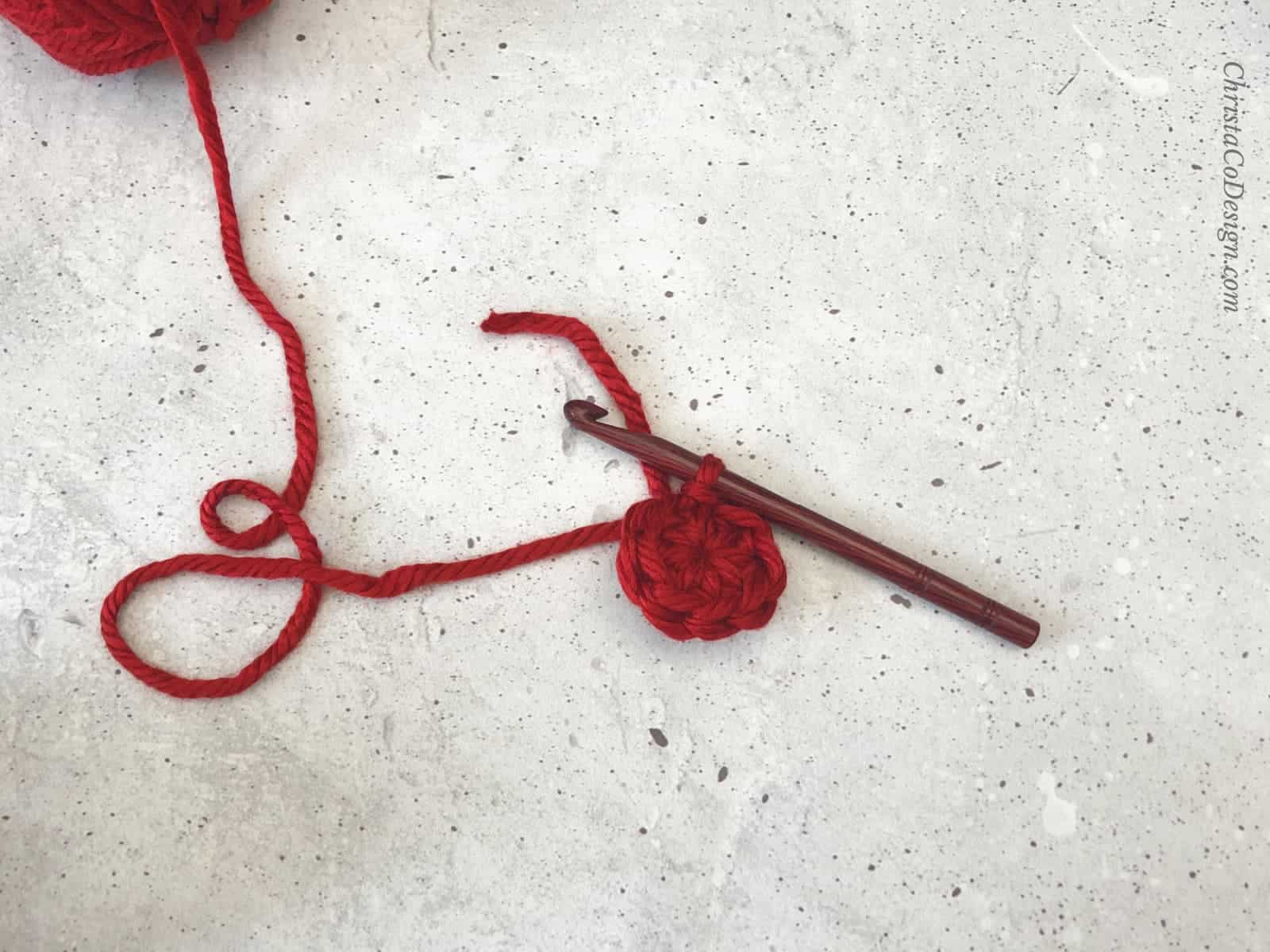 Crochet circle in red.