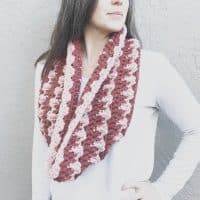 Chunky cowl worn by model in white.