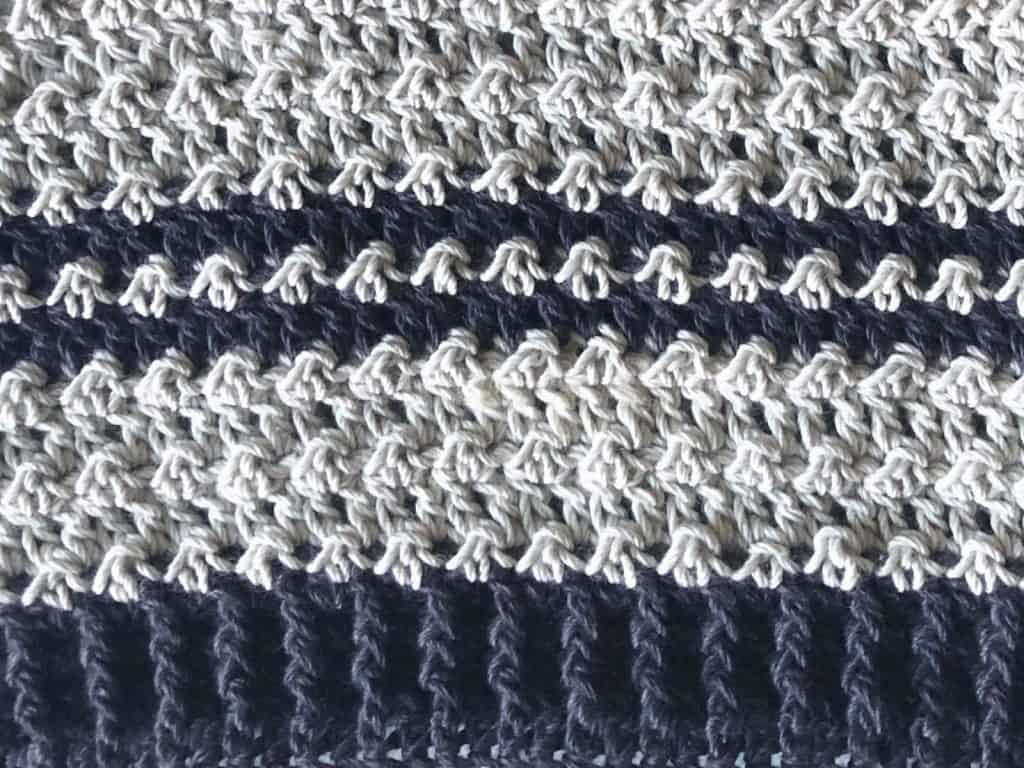 Two center stripes in dark grey.