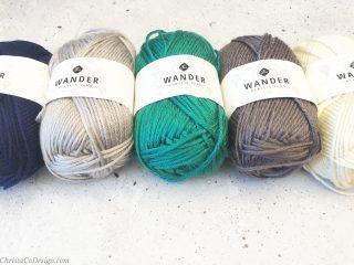 Furls Wander acrylic yarn in blue, grey, teal, grey and white.