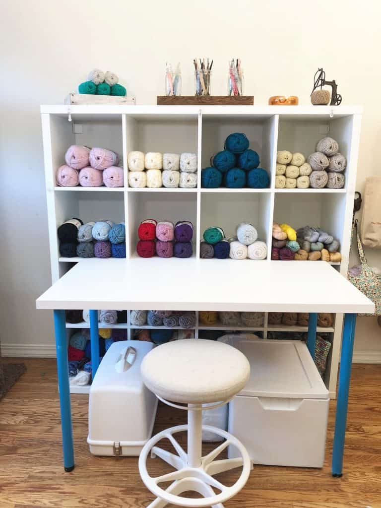 Yarn filled shelves and table.