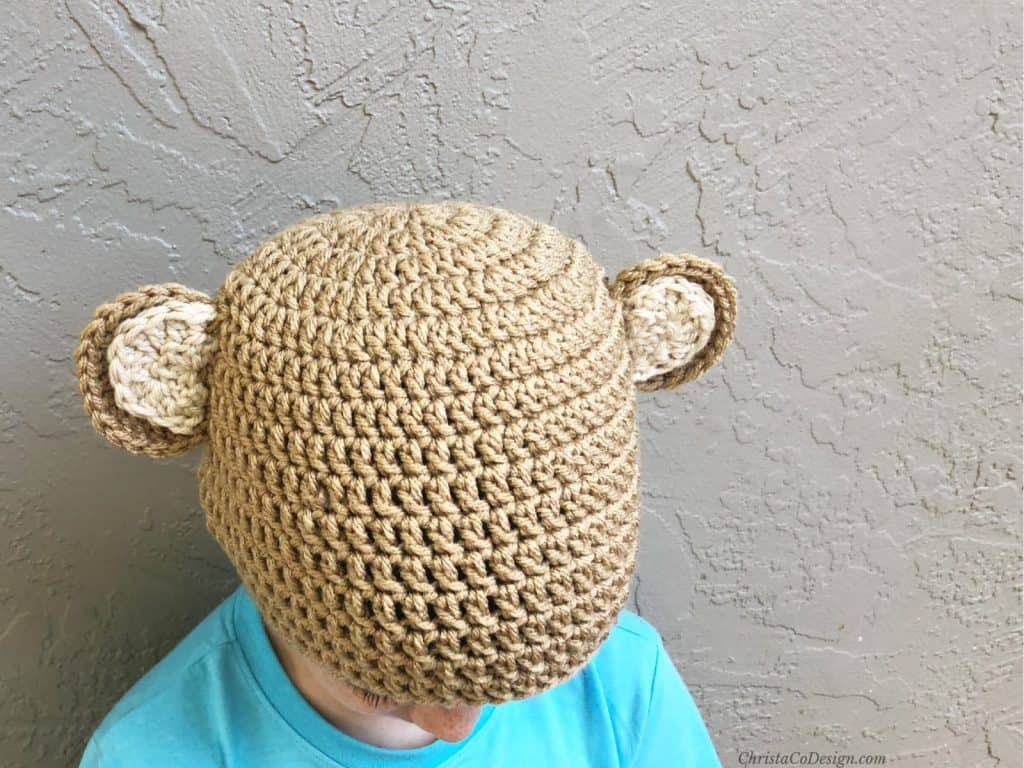 Crochet bear hat with ears in light brown.