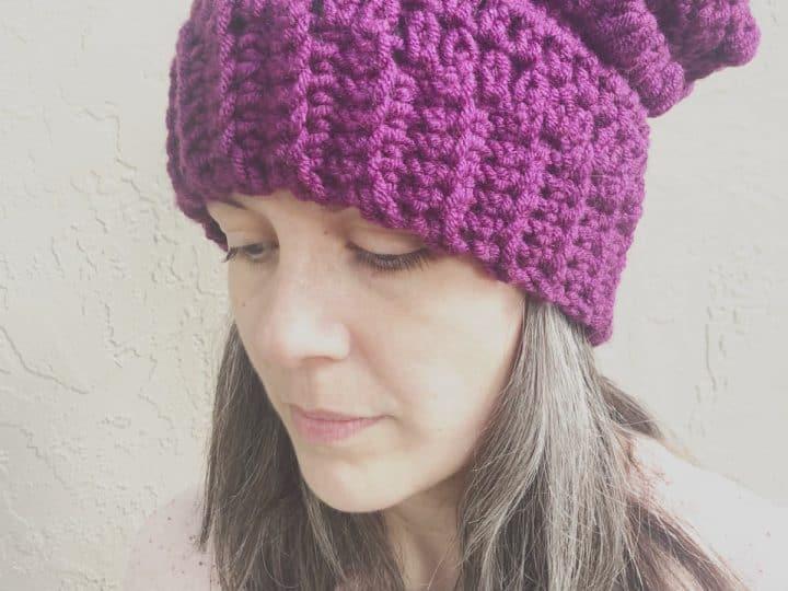 Woman in purple slouchy hat.