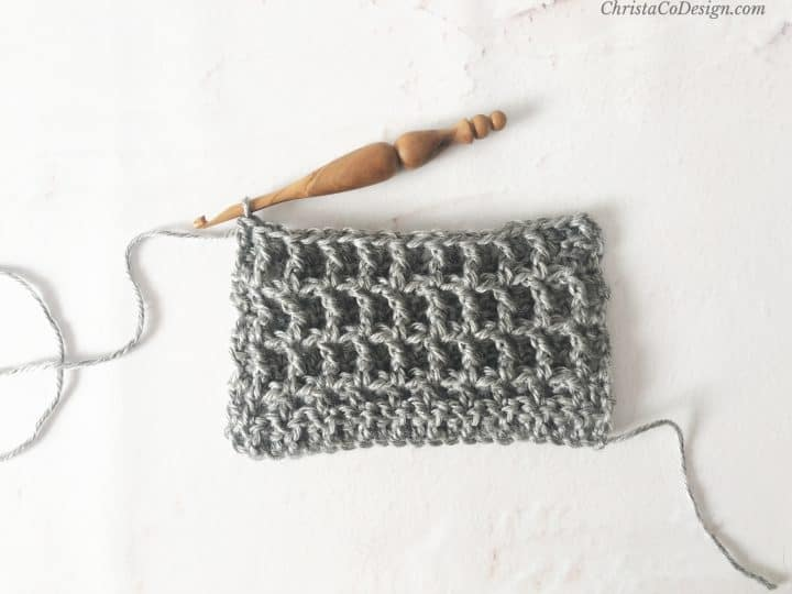 Post stitches back and front worked in grey yarn.