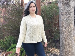 Woman in white crochet cardigan.
