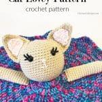 Crochet cat lovey in purple blanket dress.