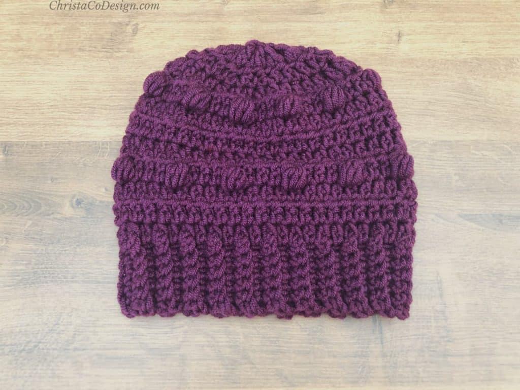 Purple hat with ribbing.