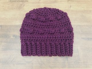 Purple hat with ribbing.
