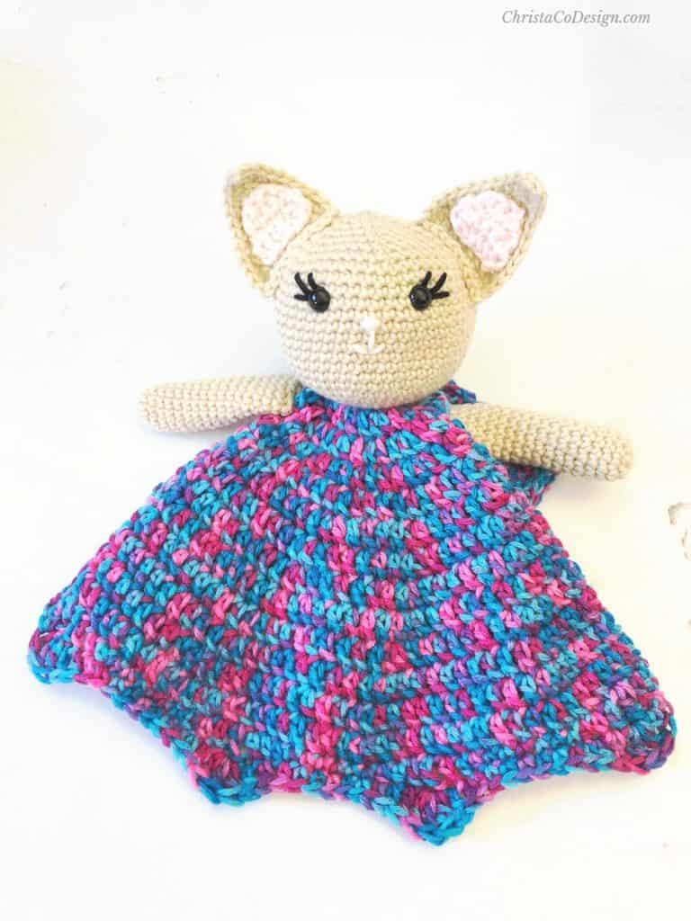 Crochet kitty lovey with blanket in variegated yarn.