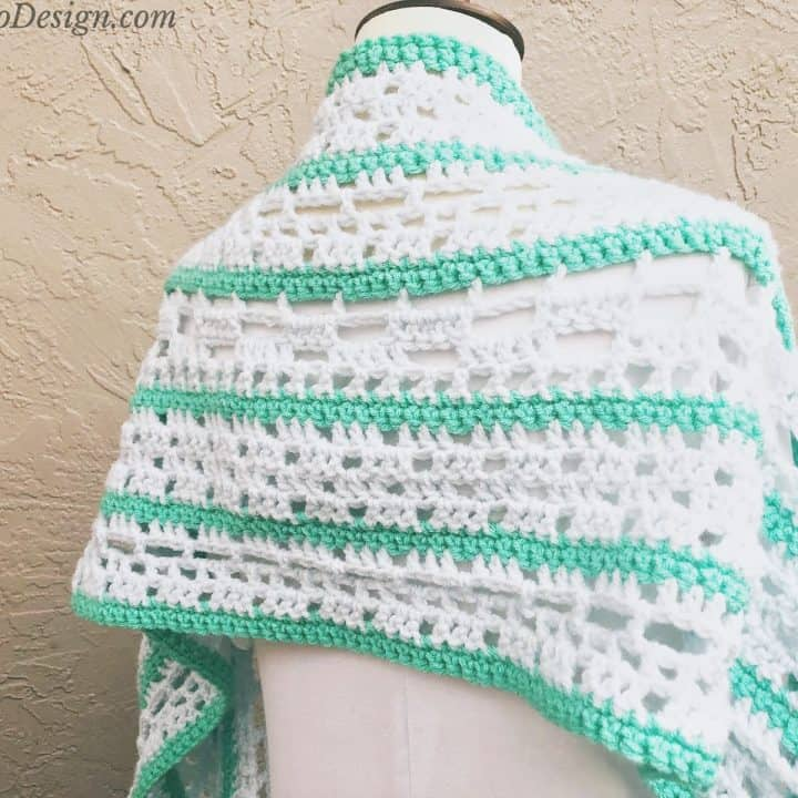 Green and blue shawl striped on mannequin.
