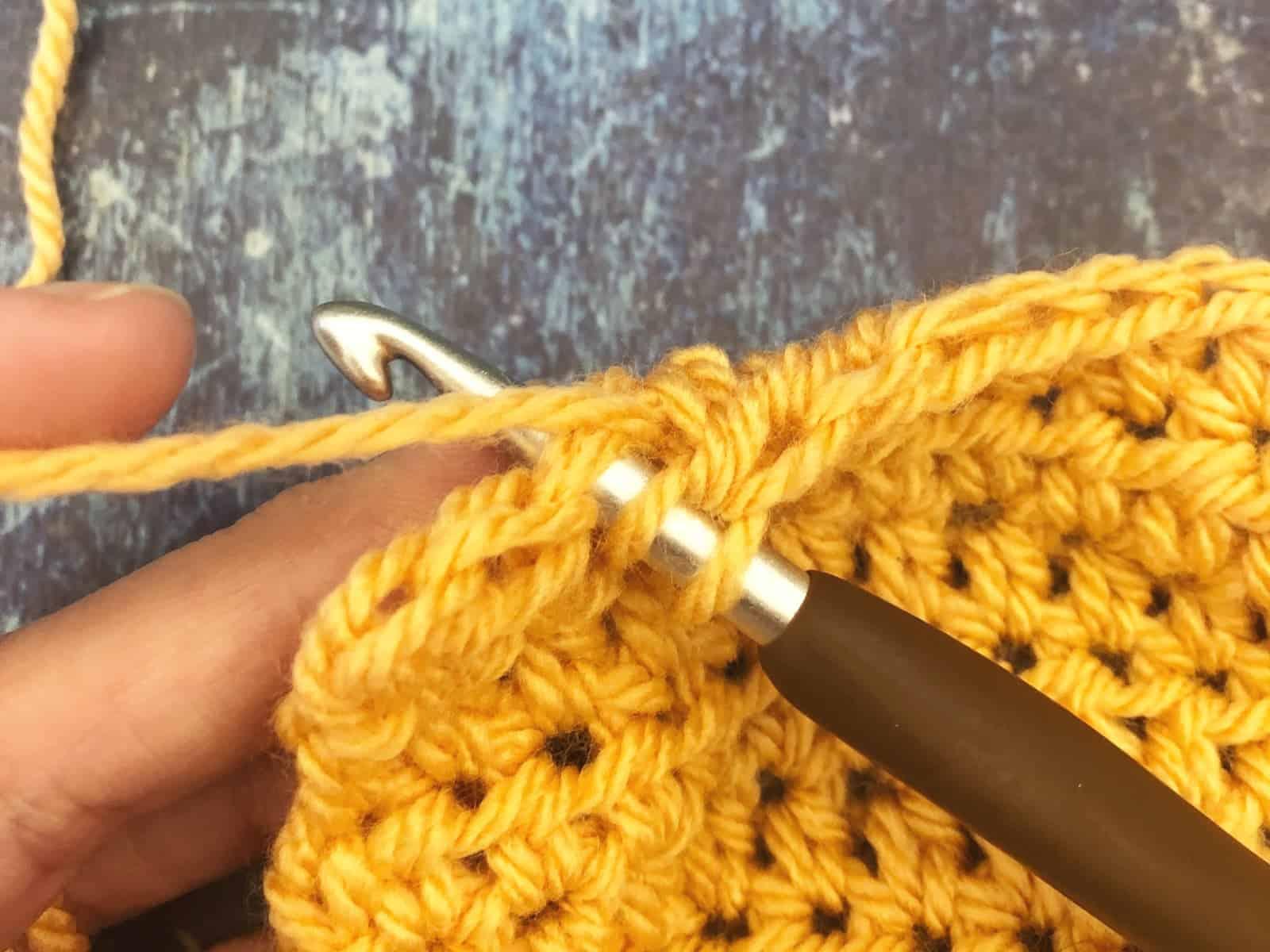 Insert hook in stitch.
