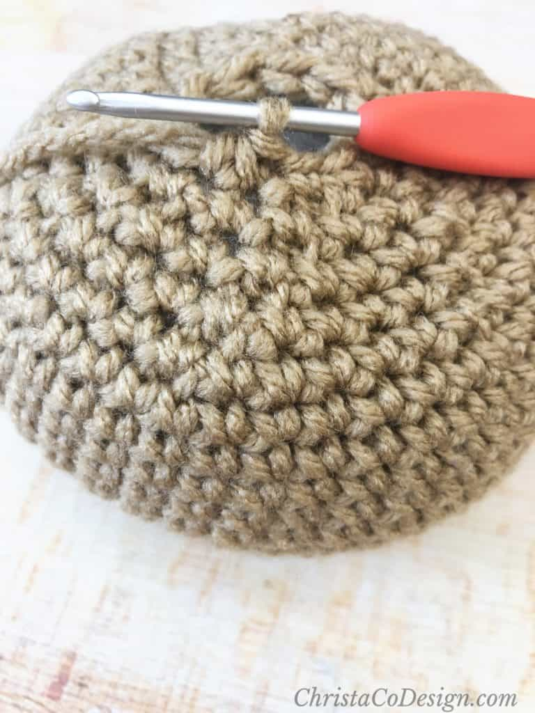 Round crochet ball with hook.