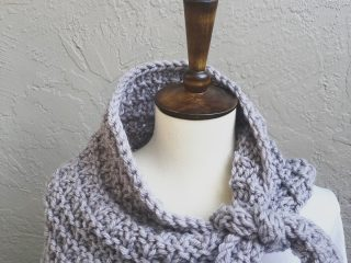 Lavender scarf tied on mannequin neck.