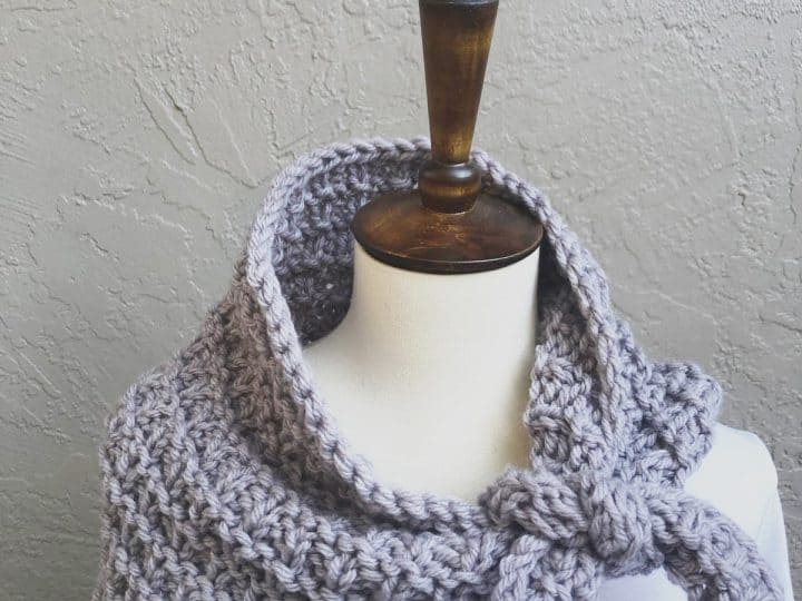 Lavender scarf tied on mannequin neck.