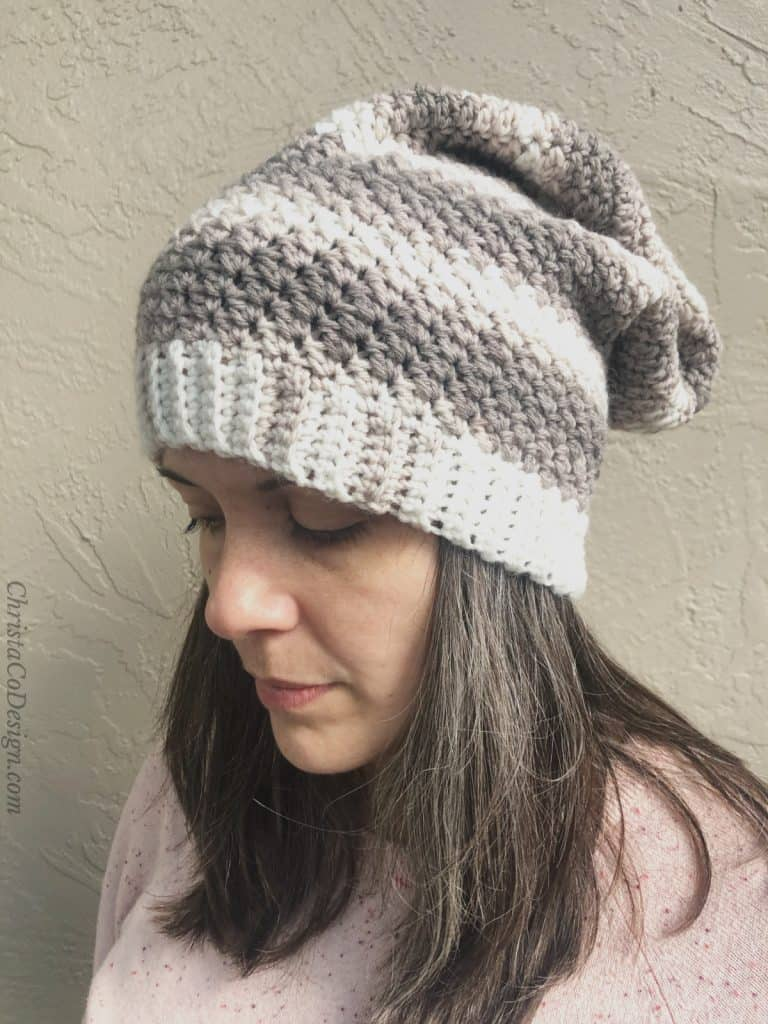 Grey and white striped slouch hat on woman.