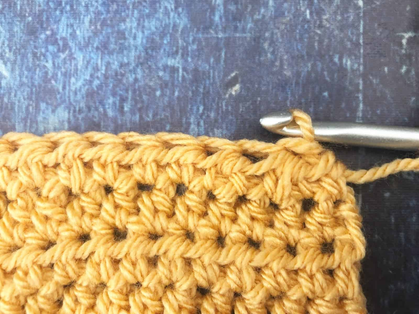 Back view of both versions of half double crochet two together.