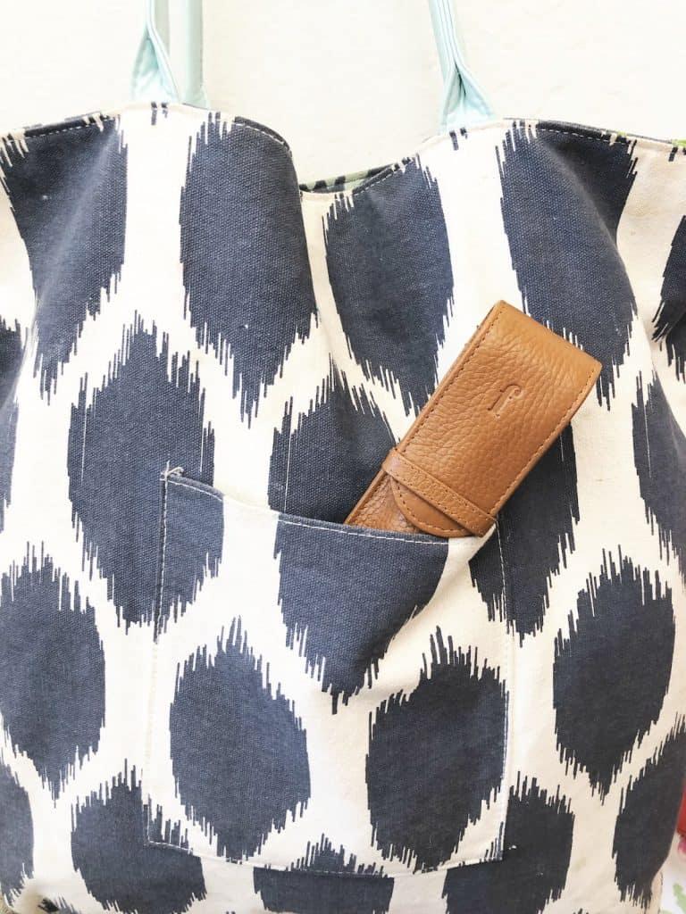 Tan hook case in pocket.