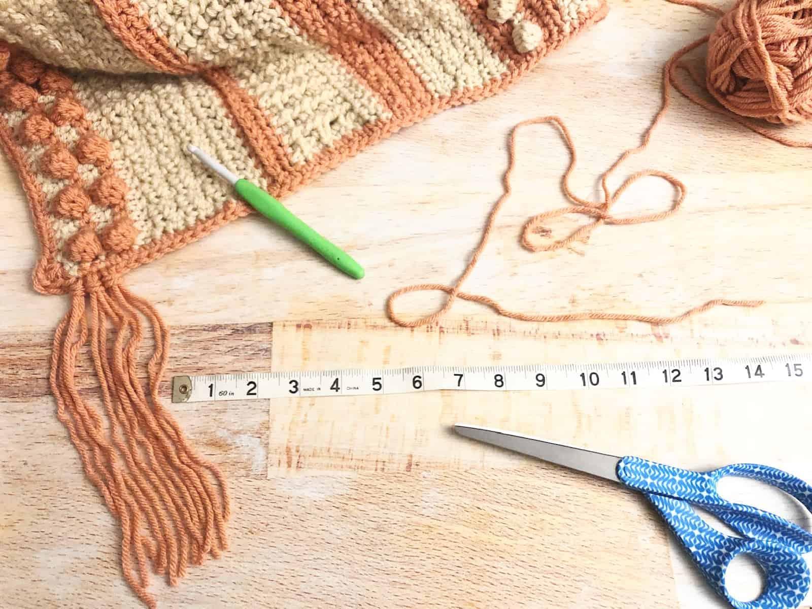 Add fringe to shawl edge.