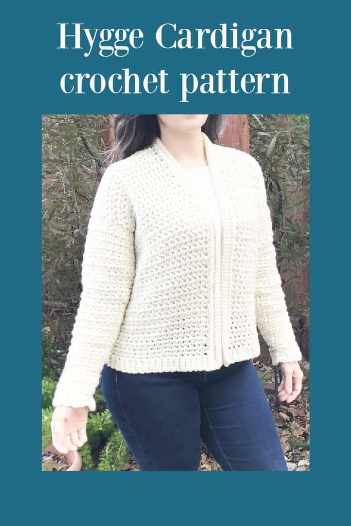 White crochet cardigan on woman.