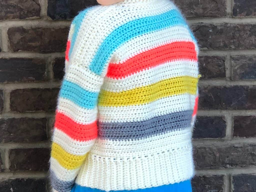 White crochet cardigan with stripes on kid.