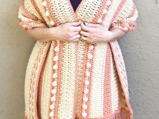 Bobble and stripe shawl wrapped around woman.