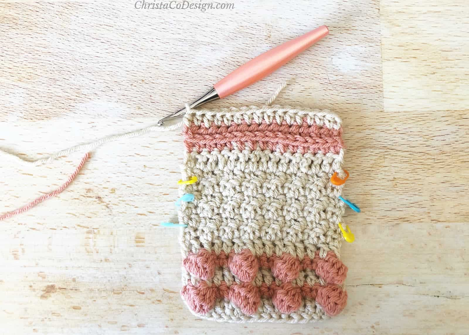 3rd loop ridge below half double crochet stitches.