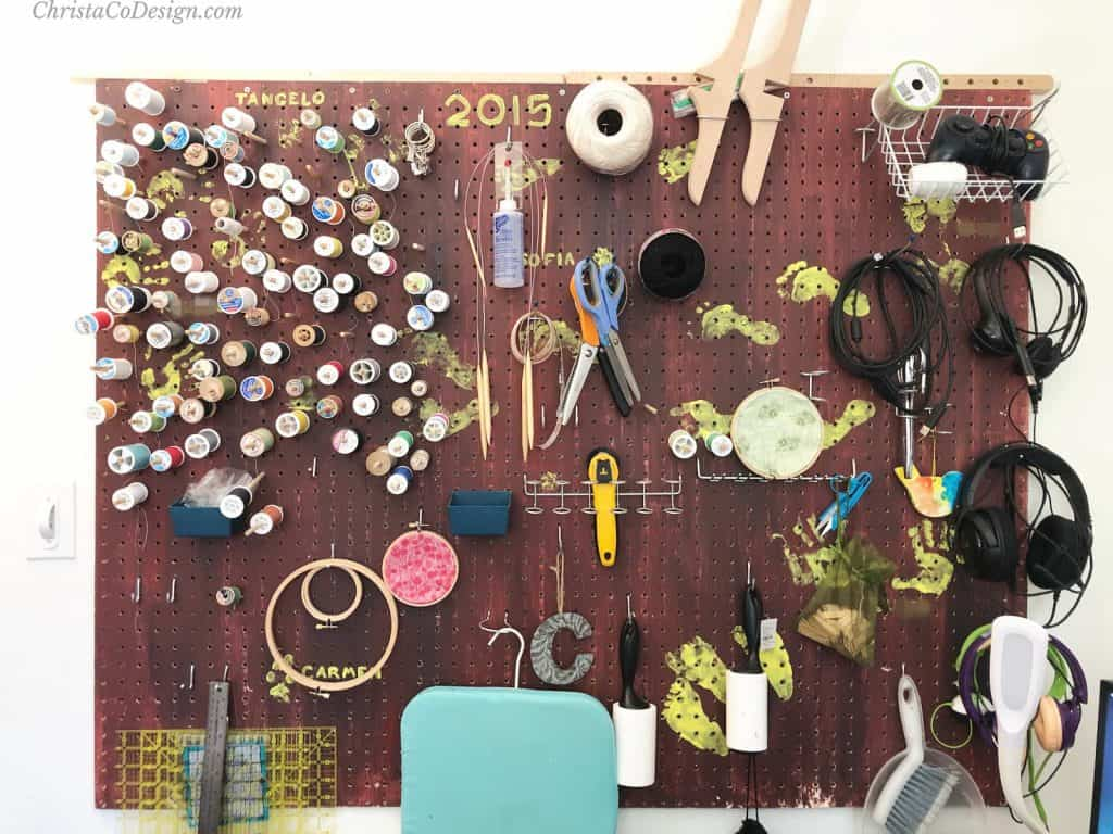 Pegboard with craft supplies.