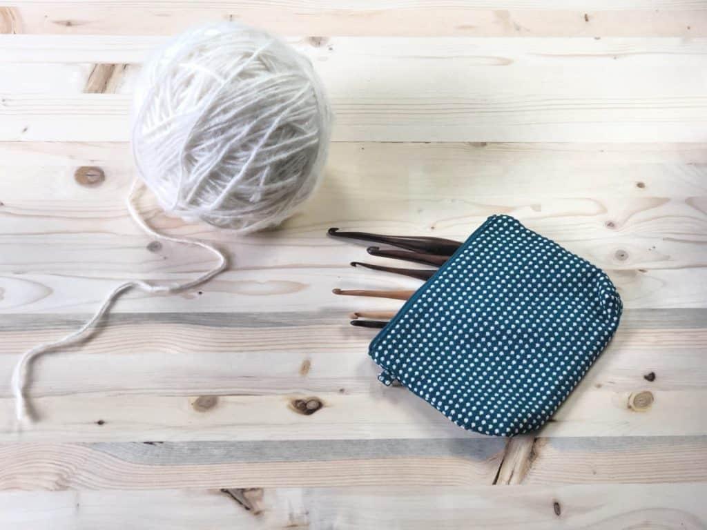 Crochet hooks in zipper pouch.