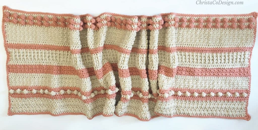 Striped and textured crochet shawl.