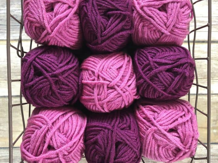 Pink and purple yarn in basket.