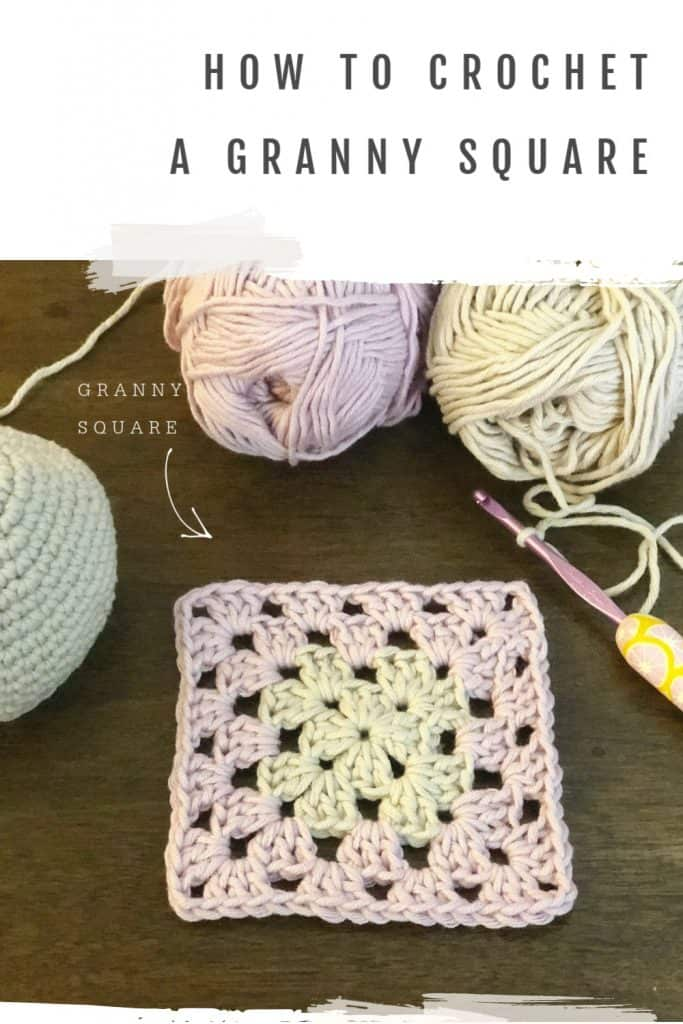 Pink and grey crochet granny square.