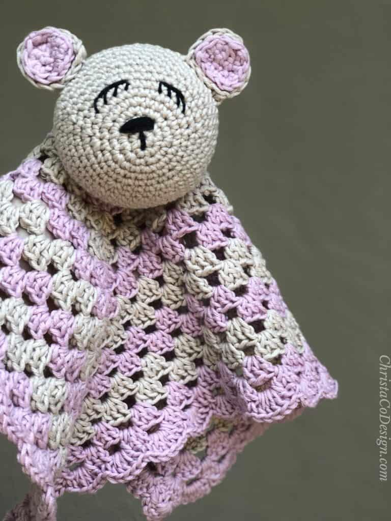 Crochet bear lovey in pink and beige.