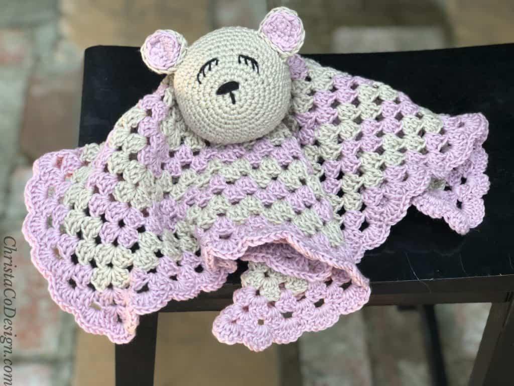 Bettie bear crochet lovey on stool.