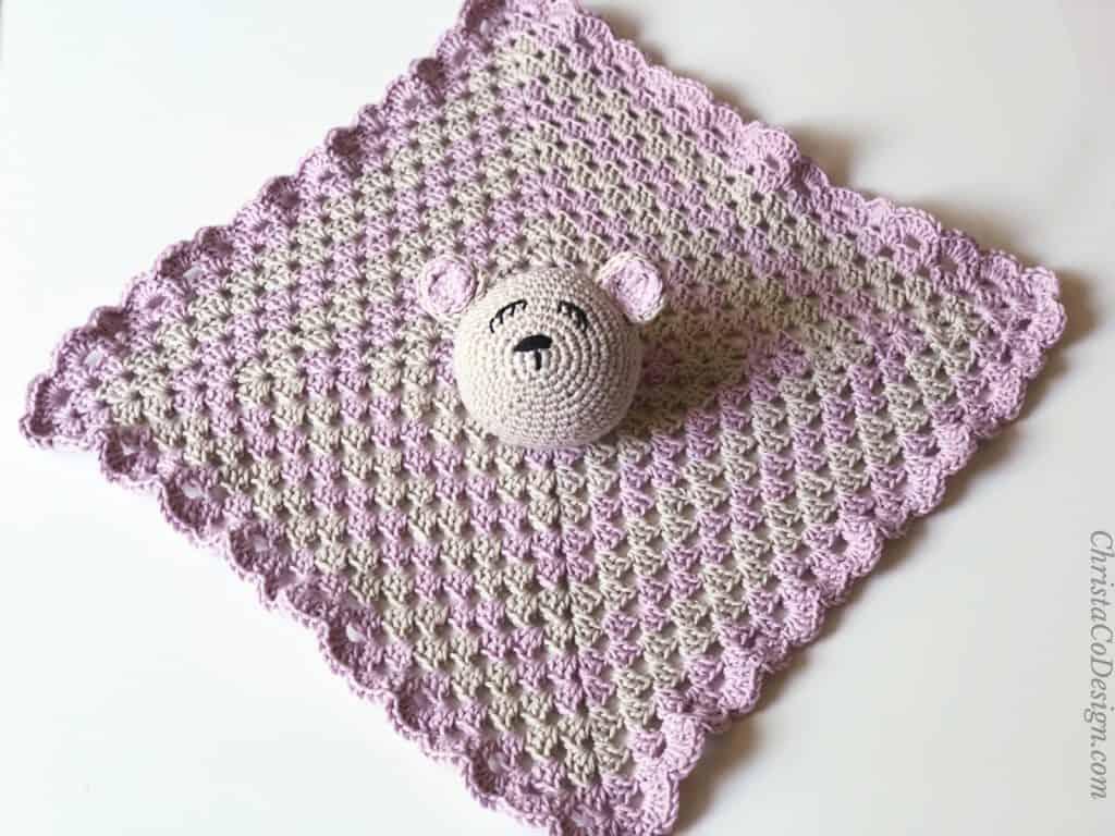 Bettie bear lovey crochet granny square open on table.