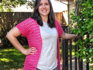 Woman smiling in pink crochet cardigan free pattern.