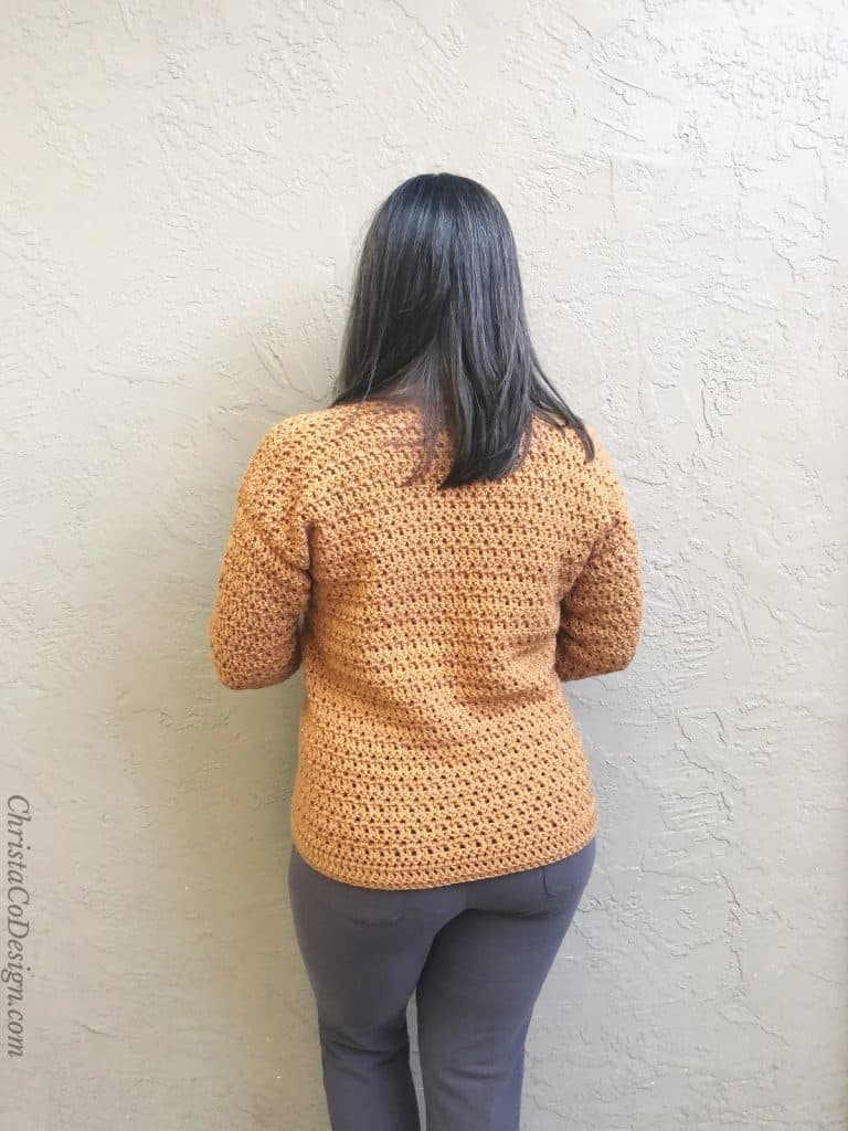 Back view of crochet sweater on woman.